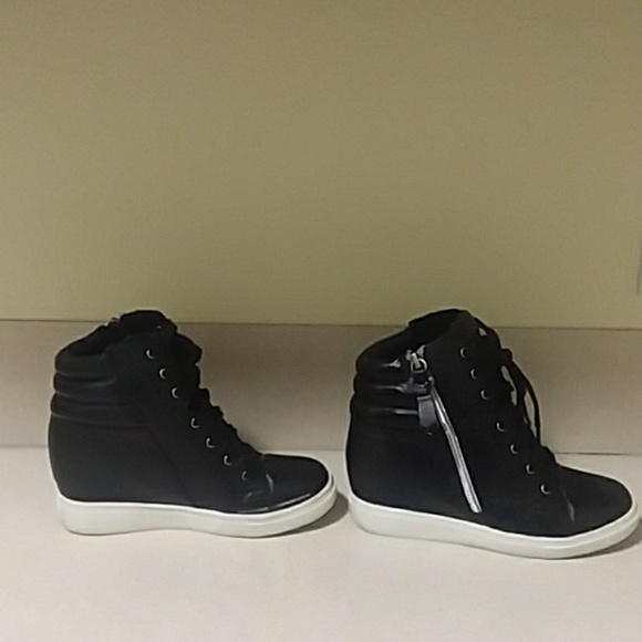 c483bec06b7 Girls Steve Madden wedge hightops. M 5c6f40b11b32941b9a89795e. Other Shoes  you may like. Steve Madden JCrush hightop sneakers